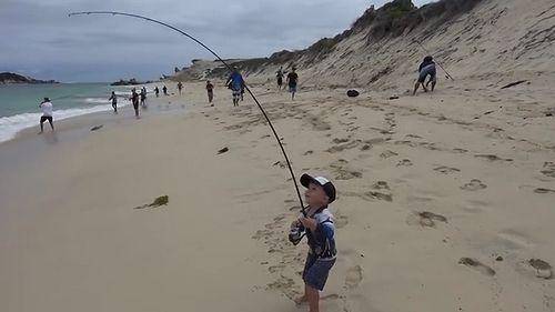 3_year_old_catching_6kg_salmon.jpg
