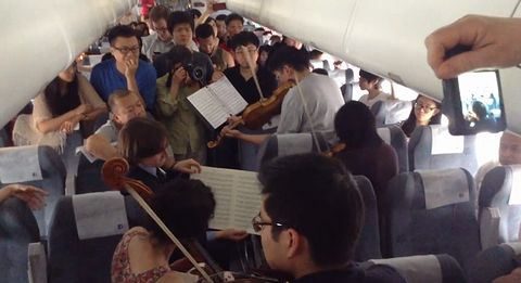 Orchestra_musicians_perform_on_flight.jpg