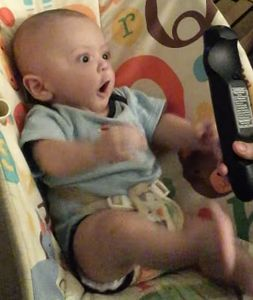 Baby_goes_crazy_over_a_remote_control.jpg