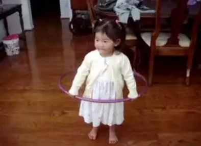 little_girl_tries_to_hula.png